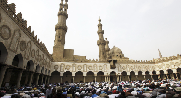 People perform Friday prayers led by Chairman of the International Union of Muslim Scholars Egyptian Cleric Sheikh Yusuf al-Qaradawi at Al Azhar mosque in old Cairo